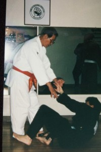 prof jay kindly helping sensei doug up with some pain in seminar hawaii