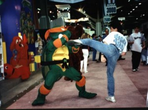 sensei doug giving ninja turtle michaelangelo roundhouse kick in las vegas